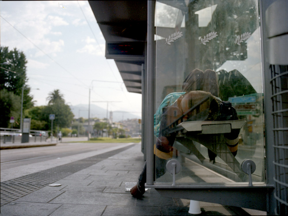 sleeping at the tram station | by bertram rusch